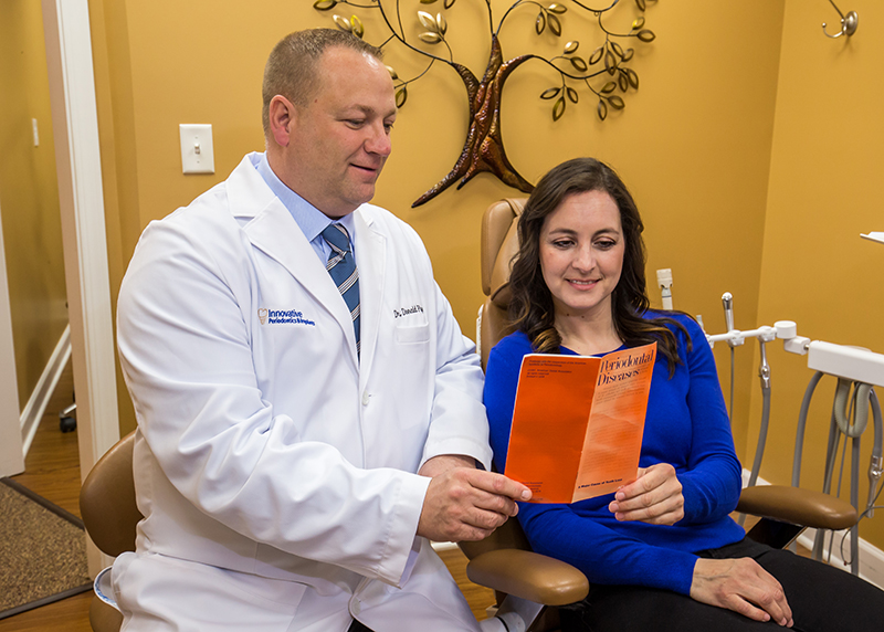 Dr. Flynn is going over laser gum disease treatment options